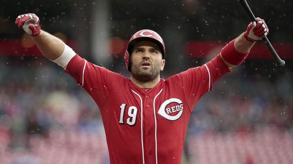 Cincinnati Reds first baseman Joey Votto (19) stretches between pitches during the bottom of the fifth inning of the MLB game between the Cincinnati Reds and the Chicago Cubs at Great American Ball Park in Cincinnati on Thursday, Oct. 1, 2015. The Reds fell to the Cubs, 5-3, in the final home game of the season.