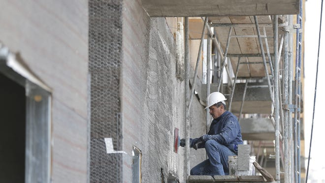 Construction was one of several industries to show strong job growth in the last 12 months in El Paso County. This man was one of the construction workers in January at the Campbell Apartments project in South El Paso.