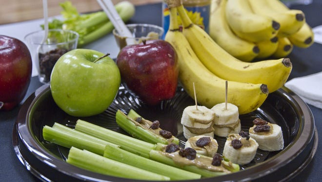 A snack of organic apples, bananas, celery, raisins and sunflower butter prepared by a ShopRite dietitian, seen in a 2013 file photo.