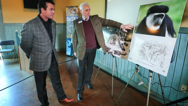 John Schnatter looks over renderings of a new exhibit on Thursday morning at the Louisville Zoo with Zoo Director John Walczak.  Thanks to a $1 million gift from the John H. Schnatter Family Foundation, the zoo's Leadership Campaign exceeded it's goal of $10.4 million for a final raised amount of $11.44 million.February 9, 2017