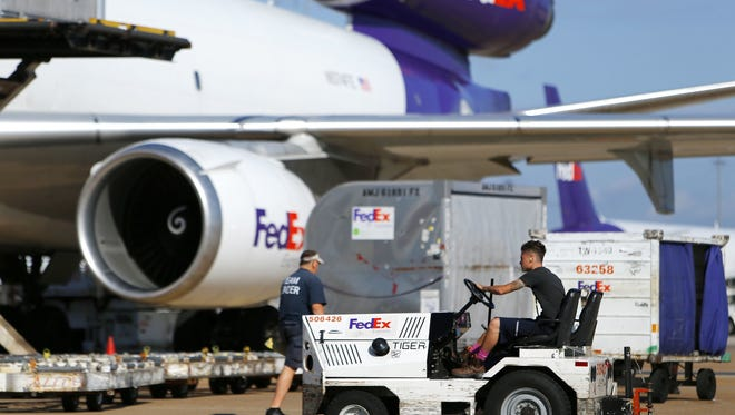 A tug operator drives across the ramp at the FedEx hub at Memphis International Airport on Oct. 18, 2016.