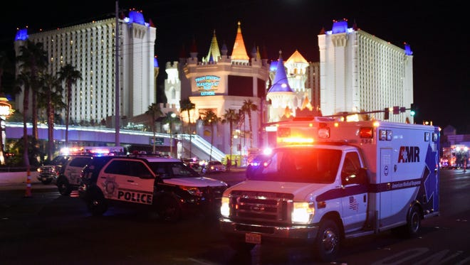 An ambulance leaves the intersection of Las Vegas Boulevard and Tropicana Avenue after a mass shooting at a country music festival nearby on Oct. 2, 2017, in Las Vegas.