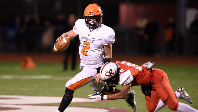 Brother Rice QB Mariano Valenti is taken down for a loss on a fourth down play late in the fourth quarter.