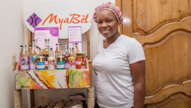 Regine Theodat with some of the products that her company, MyaBel, produces in Haiti. Theodat left Boston and the start of a promising career in corporate law to return to Haiti after the 2010 earthquake. She found out that what Haitians wanted more than anything was work.