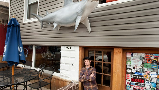 Co-owner and head chef Chase Mucerino stands in the entrance door of his restaurant, Hammerheads, at 921 Swan Street. The eatery  is named after the fiberglass fish Mucerino found in his dad's basement that now hangs above the restaurant front door. Mucerino said until they opened the restaurant, there was no space big enough to hang the fish.