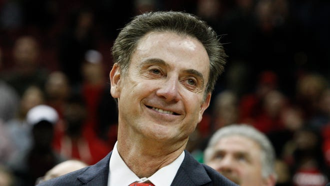 U of L head coach Rick Pitino smiled as he watched the video board after he won his 700th victory against Cleveland State and was honored at the conclusion of the game at the KFC Yum! Center.Nov. 26, 2014