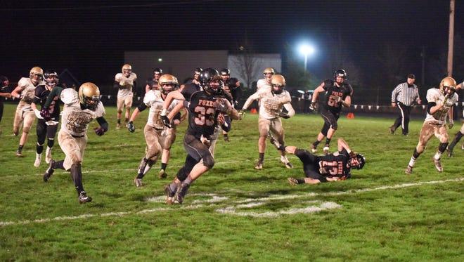 Silverton High's Sam Kuschnick runs through Pendleton's defense during his school's school's playoff game on Nov. 7.