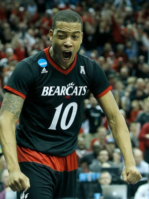 Bearcats guard Troy Caupain reacts during Saturday's game against Kentucky.