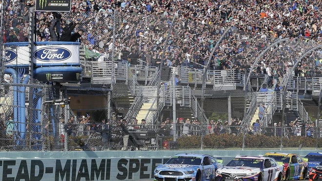Denny Hamlin (11) leads the field to start the NASCAR Cup Series auto race on Sunday, Nov. 17, 2019, at Homestead-Miami Speedway in Homestead, Fla.