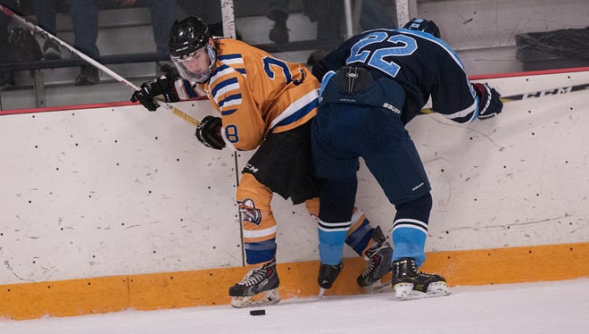 Schoolcraft defenseman Bayley Brothers (No. 28) of Livonia sidesteps a check by Northwood's Brendan McCarthy.