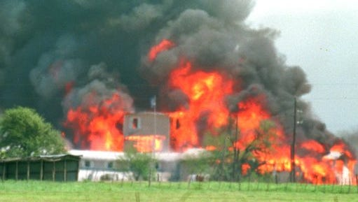 FILE - In this April 19, 1993 file photo, fire engulfs the Branch Davidian compound near Waco, Texas.  A six-part television series covering a deadly standoff between the federal government and the Branch Davidians spiritual sect more than two decades ago will be filmed in New Mexico.