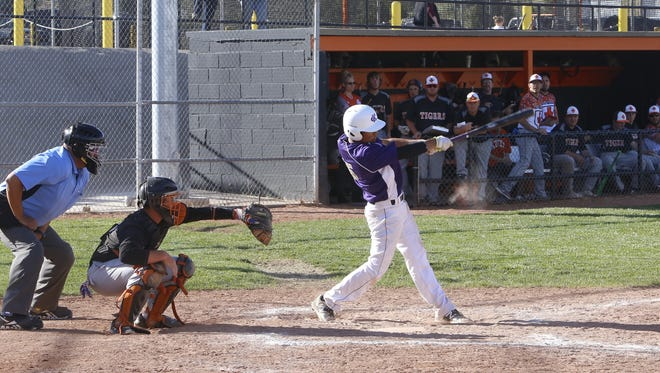 Kirtland Central's Cochise Sorrelhorse connects on a pitch against Aztec on Thursday in Aztec.