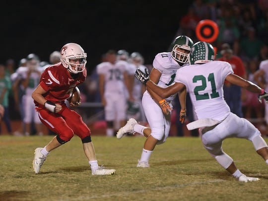 Christoval Cougar David Fava tries to maneuver through the Eldorado Eagles defense during Friday night's game in Christoval, Oct. 13, 2017. Christoval won 31-0.