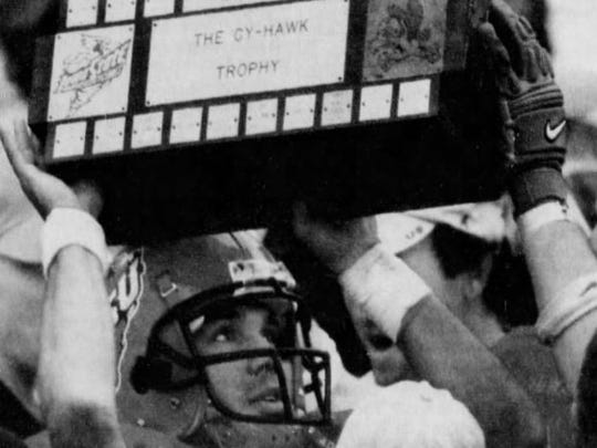 Iowa State receiver Craig Campbell carries the Cy-Hawk Trophy off the field after the Cyclones beat Iowa, 17-14, on Nov. 24, 2001, at Jack Trice Stadium in Ames.