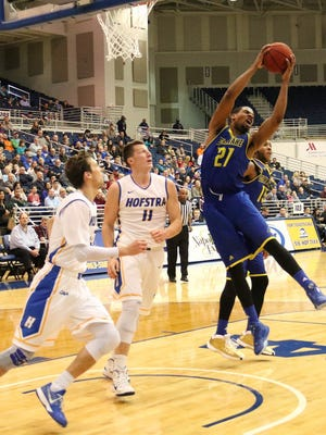 Delaware's Marvin King-Davis grabs a rebound in front of Hofstra's Rokas Gustys (11).