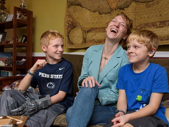 Clare Consavage of Claymont and sons Colin, 10, and
