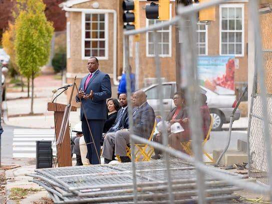 Steven Martin, Executive Director Wilmington Housing Partnership, makes remarks in November 2015 at the former site of Walt's Flavor Crisp.