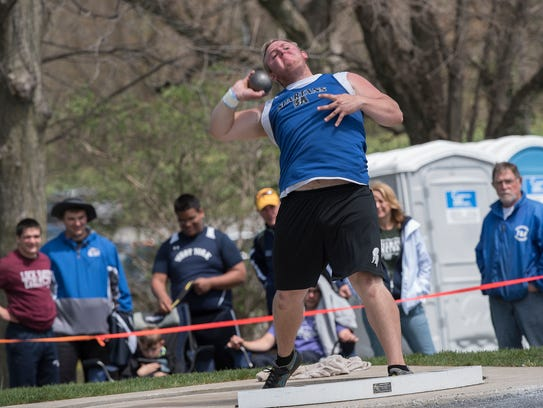 McConnellsburg's Connor Johnson throws the shot put