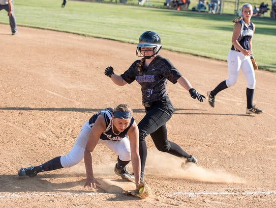 Chambersburg's Laken Myers tries to tag out Selena