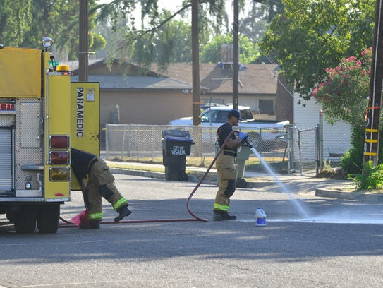 Fire crews wash down blood after homicide in Visalia