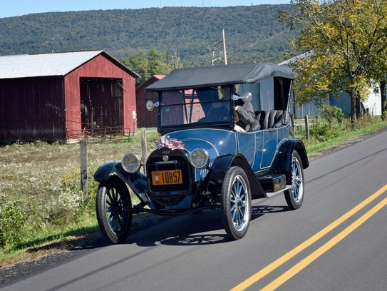 Richard Miller, McConnellsburg, drives his 100-year-old