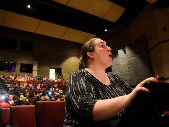 First year music teacher Kristen Durrell sings along