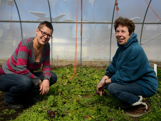 Urbandale Farm Manager Caitlin Schneider, left, and