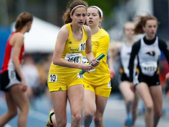 Bailey Nock from Iowa City West takes the baton during