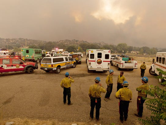 Members of the Blue Ridge Hotshots watch as the Yarnell