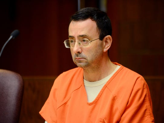 Larry Nassar listens during his preliminary hearing on sexual assault charges on May 26, 2017 at the 55th District Court in Mason.