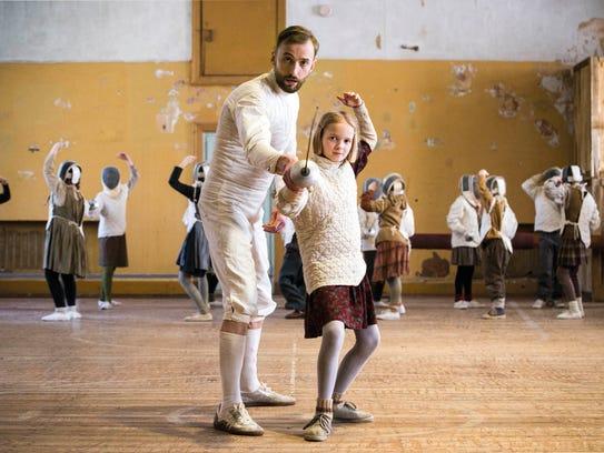 "In ""The Fencer,"" Endel (Märt Avandi) instructs Marta"