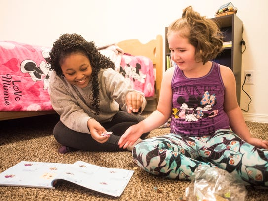 Rahja Steel, 12, and Jaydee Doland, 7, play with legos