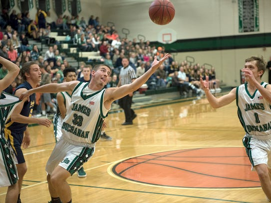 James Buchanan's Hunter Sowers (33) reaches for a rebound