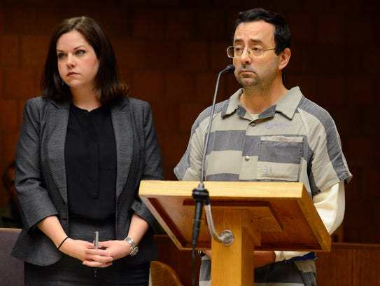 Attorney Shannon Smith stands next to Larry Nassar as he appears in court on Friday, Jan. 20, 2017, during a motion hearing at the 55th District Court in Mason.