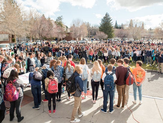 Reno High School students gather on the front steps