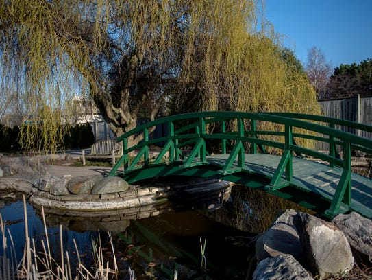 A bridge over a pond pictured at the Michigan 4-H Children's