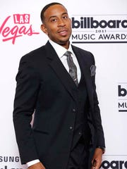 Host Ludacris poses in the press room at the Billboard