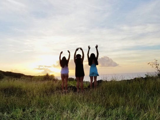 Audria Cruz and friends take in the sunset at Priest Pools in this  Dec. 11, 2016, file photo.