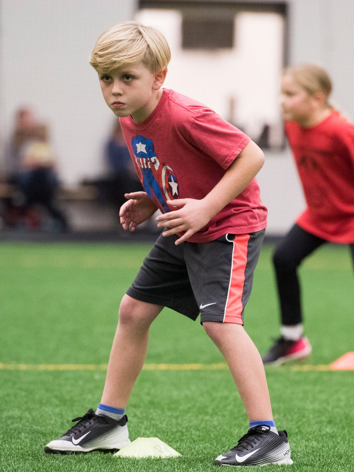 Tyce Edwards, 7, practices his tackling form at a clinic