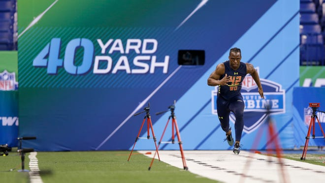 UW wide receiver John Ross runs the 40-yard dash at the NFL scouting combine Saturday in Indianapolis.