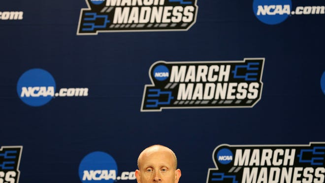 Xavier Musketeers head coach Chris Mack takes questions from reporters, Thursday, March 15, 2018, at Bridgestone Arena in Nashville.