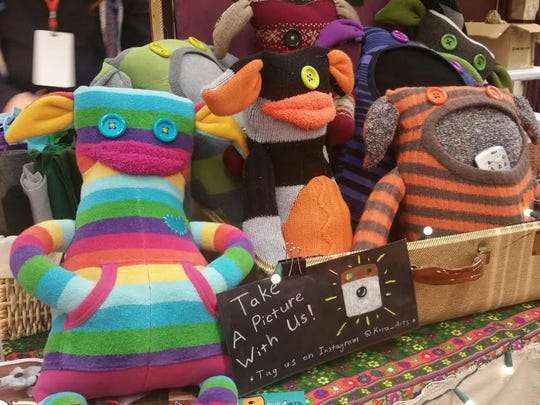 """A variety of colorful """"Sweater Monsters,"""" made by Kira Arts, were on display at the Rochester Mini Maker Faire on Saturday."""