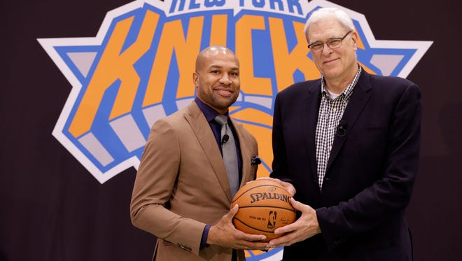Knicks president Phil Jackson, right, will be held more accountable for the team's success than new coach Derek Fisher.
