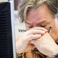 """A scene from the Oscar-winning documentary short film, """"Crisis Hotline: Veterans Press 1."""" Some veterans say they endure long wait times when trying to access VA's hotline. (AP Photo/HBO Documentary Films)"""