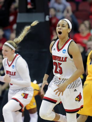 Louisville's Asia Durr celebrates after she knocks down a three and Marquette calls a timeout.