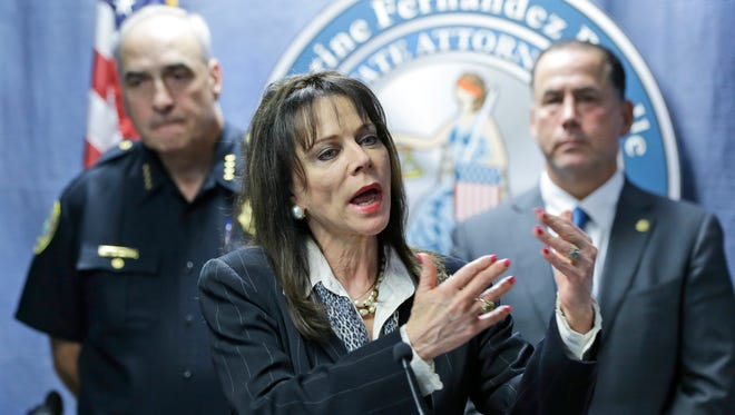 Miami-Dade State Attorney Katherine Fernandez Rundle, center, speaks during a news conference as Miami Beach, Fla., Chief of Police Daniel Oates, left, and Miami Beach Mayor Philip Levine, right, listen Thursday, May 14, 2015, in Miami.