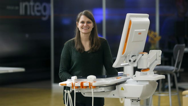 Ashly Weeks, a Computer Systems Analyst at Carestream, with the Carestream Touch Prime Ultrasound machine.
