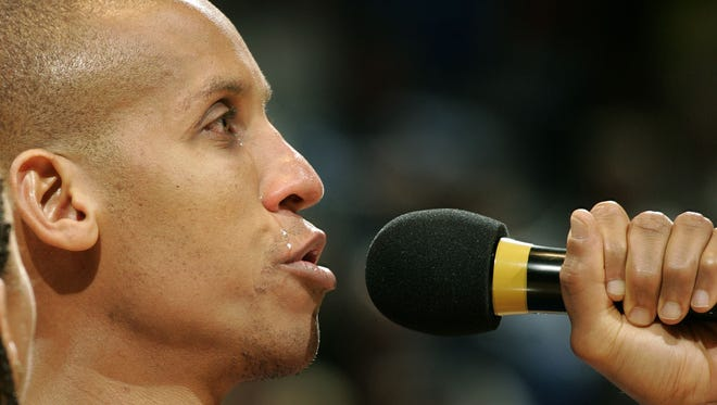 Reggie Miller, with tears rolling down his face, thanks the crowd one last time after his post-game sendoff. The Indiana Pacers host the Chicago Bulls at Conseco Fieldhouse Wednesday, April 20, 2005, for the last regular season home game, and the last regular season home game for Reggie Miller, who is retiring after this season. The Pacers won the game 85-83.