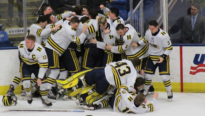 Hartland players celebrate after winning the Division 2 state hockey final on Saturday, March 10, 2018.