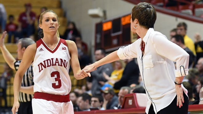 Indiana Hoosiers guard Tyra Buss (3) receives a high five from Indiana Hoosiers head coach Teri Moren as she checks out of the game against Milwaukee at Simon Skjodt Assembly Hall in Bloomington, Ind., on Sunday, March 18, 2018.